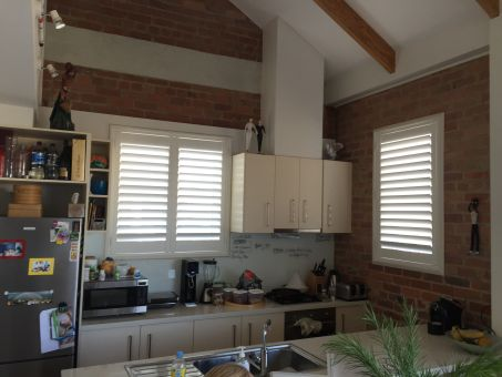 89mm PVC clearview shutters in apartment kitchen essendon